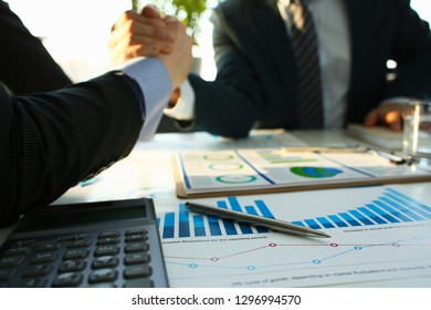Businessman in sut hand shake in ofiice closeup. Introduce manager job man risk chart paper how deal teamwork agency employment complite finish paperwork concept