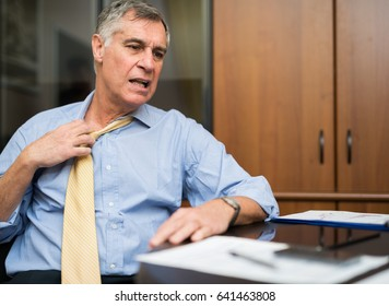 Businessman sweating in his office