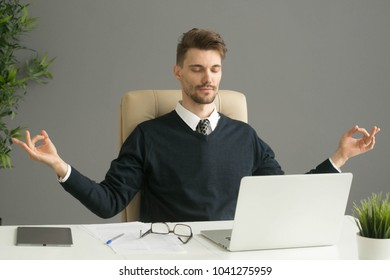 Businessman table with laptop working  and relaxing, casual office day