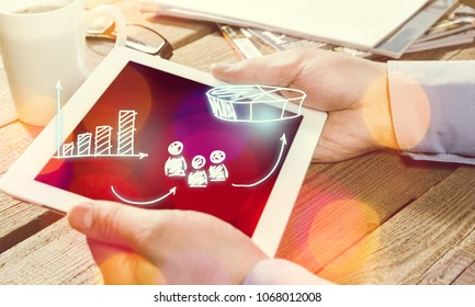 Businessman with tablet computer and diagram