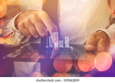 Businessman with tablet computer and diagram, infographics visual aid for business efficiency