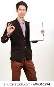 Businessman with tablet computer makes the gesture of OK .on a white background
