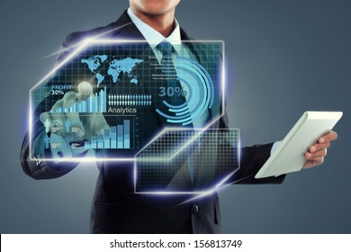 Businessman with tablet computer working on screen over virtual background