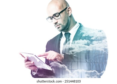 Businessman with tablet double exposure with sky and glass facade isolated on white
