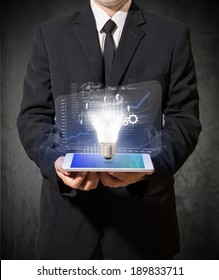 businessman with tablet of idea high technology