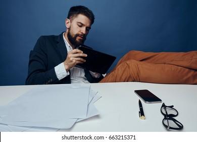 Businessman, businessman with tablet, businessman on blue background