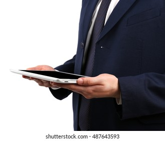 Businessman with tablet on light background