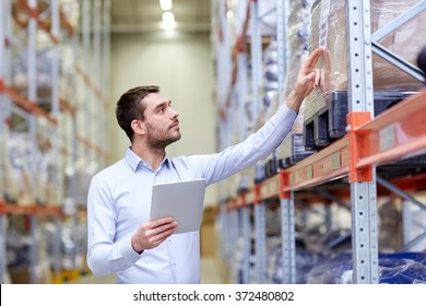 businessman with tablet pc at warehouse
