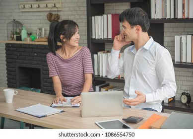 businessman takeing phone and  discuss with businesswoman information  on homeoffice