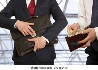 Businessman taking bribe.  Business concept