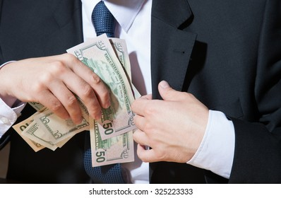 Businessman taking dollars, closeup shot