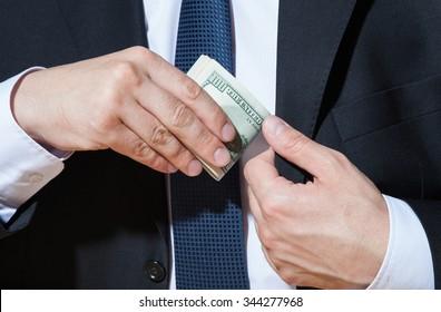 Businessman taking dollars, closeup shot