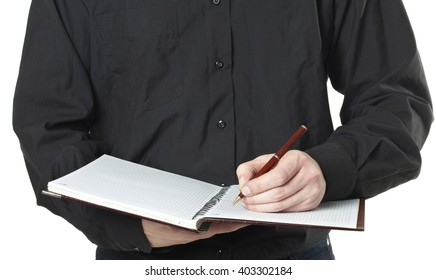 businessman taking note in a notepad