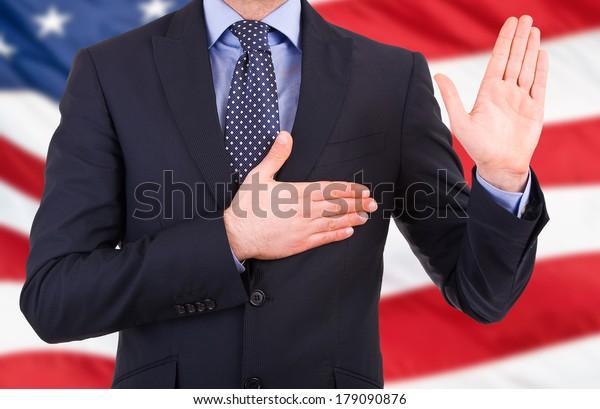 businessman-taking-oath-600w-179090876.j