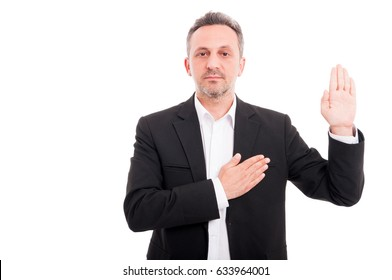 Businessman taking oath or making a promise as sign of loyalty on white background