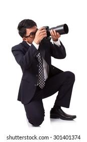 Businessman taking a photo on white background