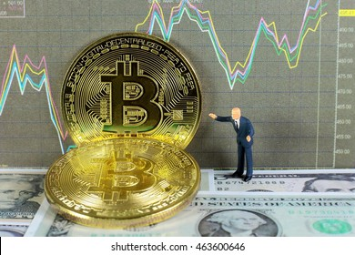A businessman is taking profit from bitcoin trading on dollar background. conceptual image for investment of crypto currency.