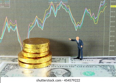 A businessman is taking profit from trading.  conceptual image for investment of stock, forex, and bitcoin.