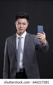 Businessman taking a selfie