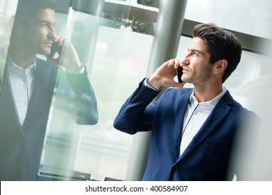 Businessman talk to cellphone and look out of window