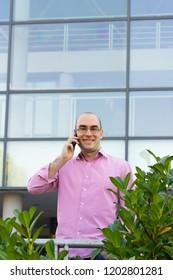 Businessman talk on phone and smile