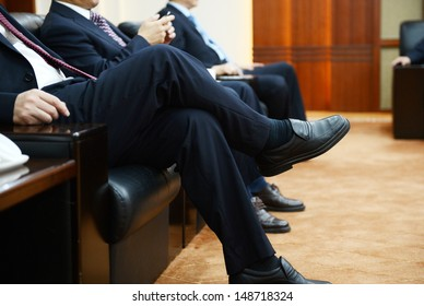 Businessman talking to each other at a meeting.