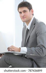 businessman talking on the Internet using a laptop
