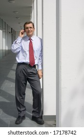 Businessman talking on mobile phone at a office building