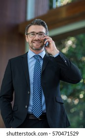Businessman talking on mobile phone at resort