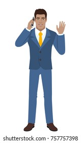 Businessman talking on the mobile phone and greeting someone with his hand raised up. Full length portrait of Black Business Man in a flat style. Raster illustration.