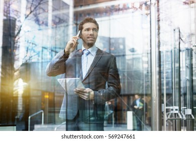 Businessman talking on the phone in financial district
