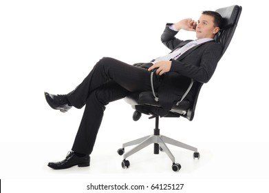 Businessman talking on the phone sitting in a chair in a bright office. Isolated on white background