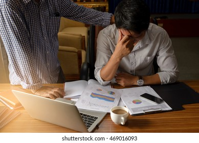 Businessman talking in stressed jobs,headaches about the job on table,his friends consoling.Stresses Business Concept