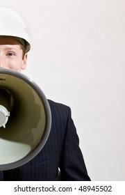 Businessman talking through megaphone