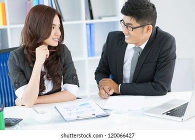 Businessman talking with a young attractive employee