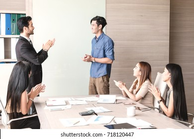 Businessman and team having meeting at meeting room in office.