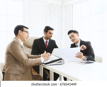 Businessman team meeting with boss and present about new project at modern office.