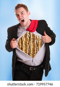 Businessman tearing his shirt piles coins on it