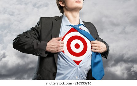 businessman tearing his shirt, under which is a target