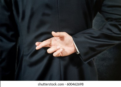 businessman telling lies, hold crossed finger his back