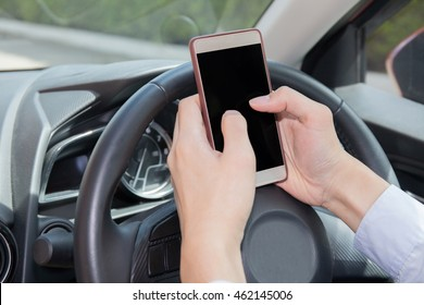 Businessman texting, chatting, playing on phone while careless driving - distraction concept - with clipping mask on screen