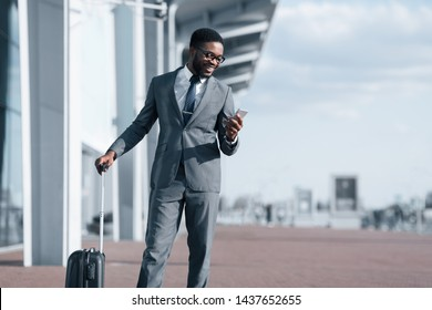 Businessman Texting On Phone, Arriving at Airport and Waiting for Taxi Outdoors