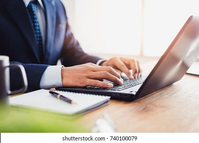Businessman that operate on table wood being checking data, Concept financial transactions online of businessman, Financier being check about financial transaction past computer.