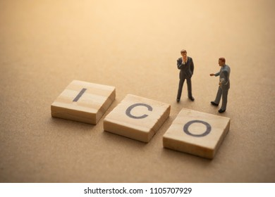 Businessman thinking about invest ICO initial coin offering concept