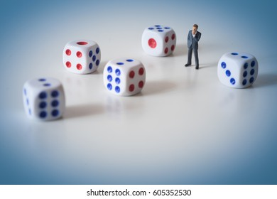 Businessman thinking with dice. Business risk concept.