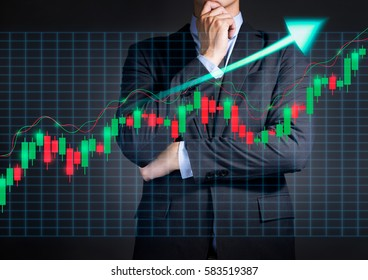 Businessman thinking to investment with candlestick graph