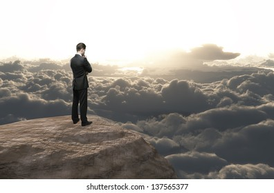 businessman thinking and looking on cloud