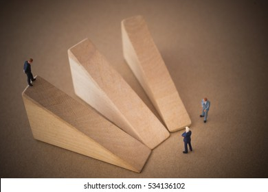 Businessman thinking or making decision in front of three option graph.
