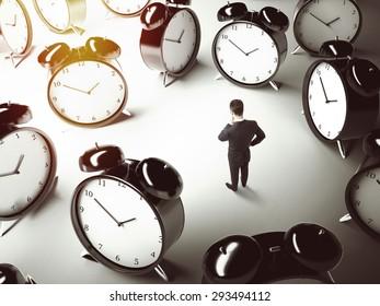 businessman thinking and many big clock  on floor