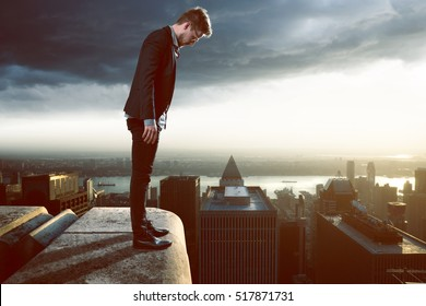 Businessman thinks about jumping from skyscraper